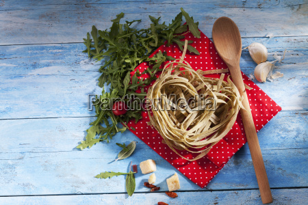 uncooked tagliatelle with rocket parmesan chili