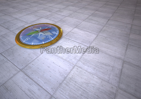 3d rendering golden compass on tiled