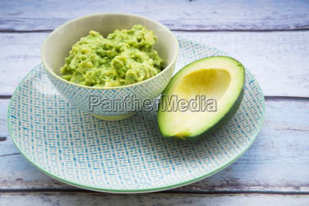 bowl of guacamole and half of