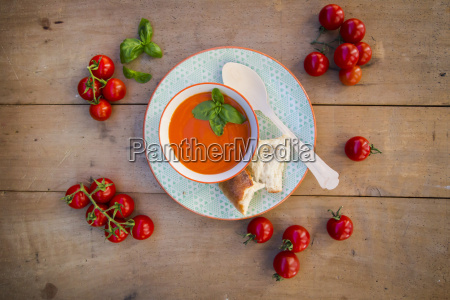bowl of tomato cream soup garnished