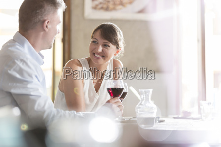 couple drinking wine and talking at