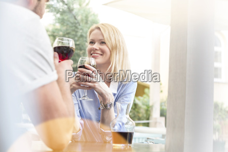 smiling couple drinking wine and talking
