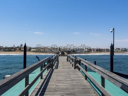 namibia swakopmund wooden pier and beach