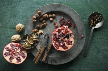two halves of pomegranate different spices