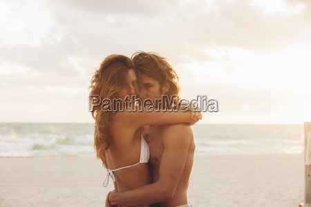romantic young couple embracing each other
