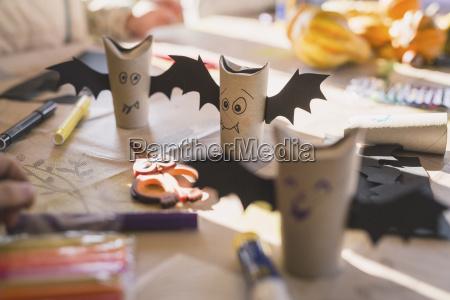tinkered paper bats on desk
