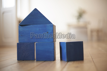 blue wooden building bricks shaping a
