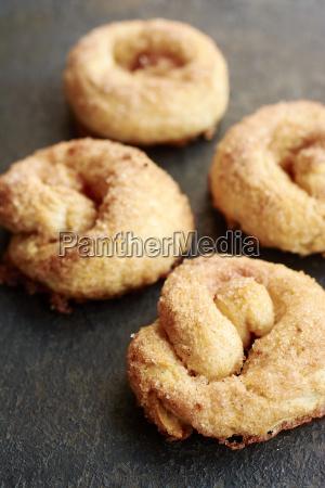 four homemade cinnamon buns