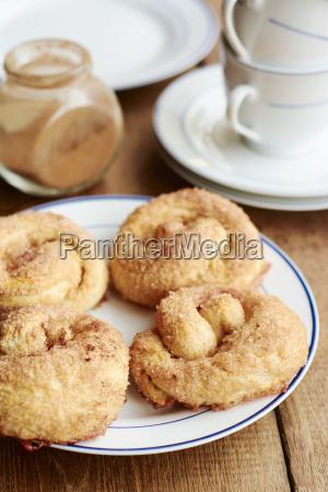 plate with four homemade cinnamon buns