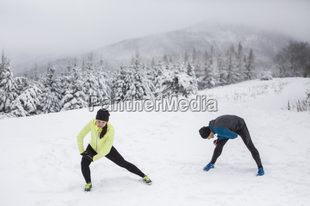 couple warming up for cross country