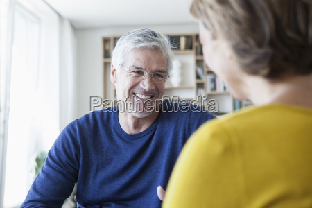 smiling man communicating with his wife