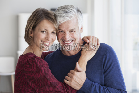 portrait of smiling couple head to