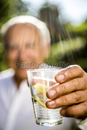 close up of senior man holding