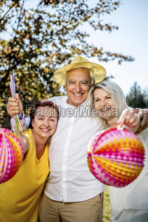 portrait of happy elderly friends with