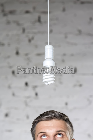 businessman looking up at energy saving