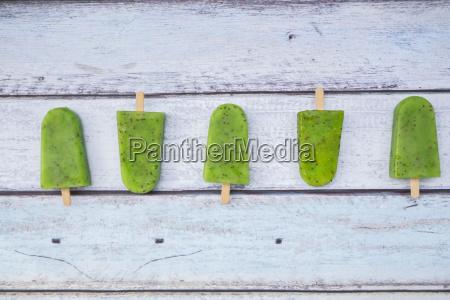 row of homemade kiwi ice lollies
