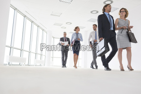 businesspeople entering new office