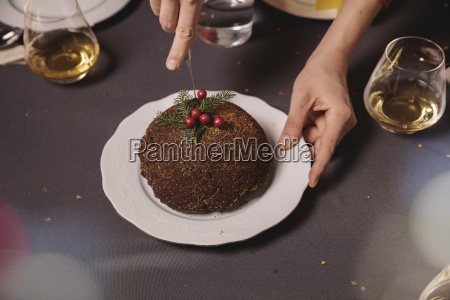 close up of christmas pudding being