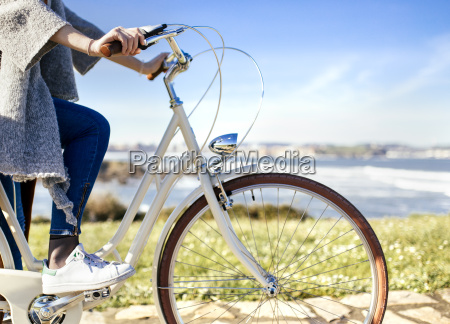 woman riding bicycle at the coast