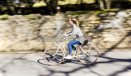 woman riding bicycle on the street