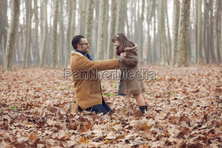 father playing with his daughter in