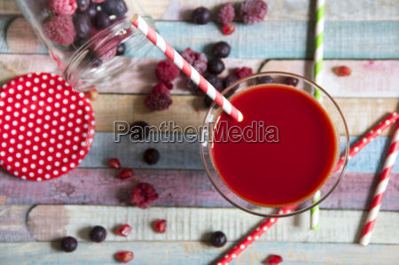 glass of red fruit smoothie