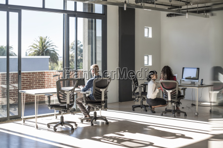 young professionals working in open office