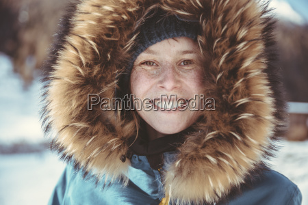 portrait of happy woman with fur