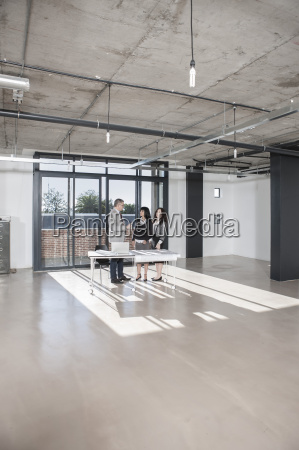 businesspeople standing and talking in new