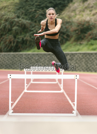 athlete woman jumping in a running