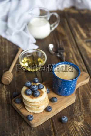 stack of mini pancakes blueberries bowl