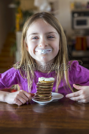 portrait of happy girl with whipped
