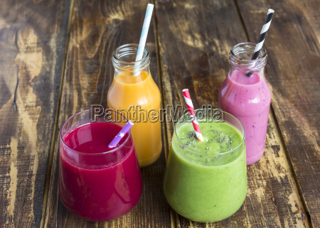 glasses of four different smoothies