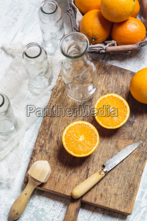 empty glass bottles and sliced orange