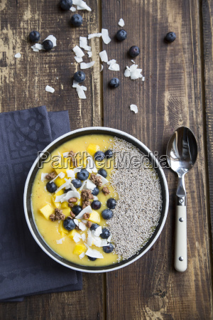 bowl of mango smoothie with diced