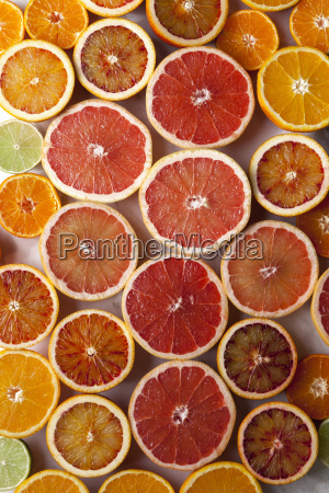 halves of different citrus fruits