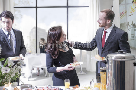 business people having buffet breakfast at