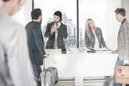businessmen arriving at office reception