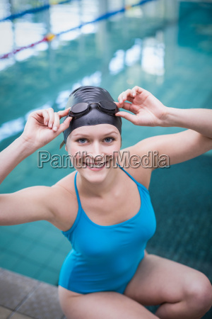 pretty woman wearing swim cap and