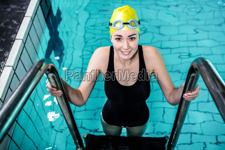 smiling swimmer woman getting out of