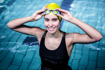 smiling swimmer woman holding her swimming