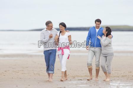 parents and adult offspring walking together