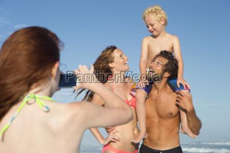 girl taking photo of family on