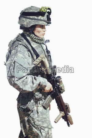 side view of female soldier carrying