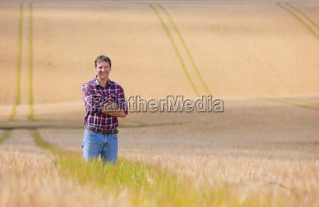 portrait confident farmer standing in sunny