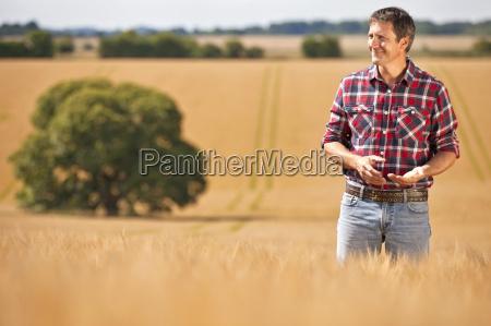 farmer looking away in sunny rural