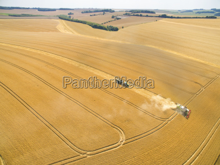 aerial landscape view of combine harvester
