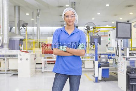portrait of technician worker looking at
