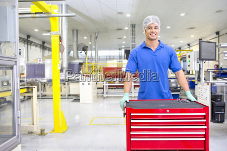 technician worker smiling at camera in