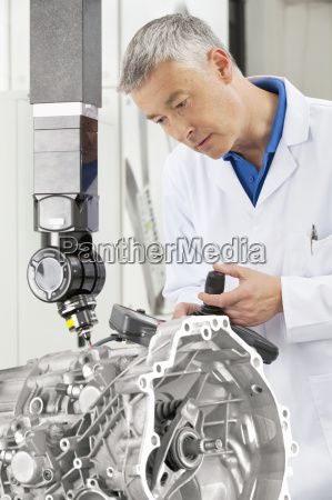 engineer with joystick controlling probe scanning